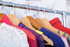 Colorful womens clothes on hangers on rack in fashion store. wom. Colorful womens clothes on wood hangers on rack in a fashion store. women`s closet royalty free stock photo