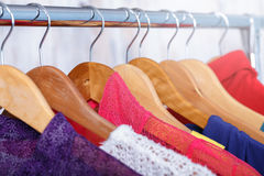 Colorful womens clothes on hangers on rack in fashion store. wom Royalty Free Stock Image