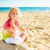 Trendy girl on seacoast blowing bubbles. Colorful and wonderfully cheerful mood. trendy girl in colorful shirt on the seacoast blowing bubbles stock images