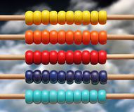 Colorful wood abacus over sky Royalty Free Stock Photography