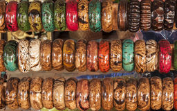 Colorful wood bangles in a row Royalty Free Stock Images