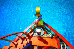 Colorful of wood boat against beautiful clear blue sea water wit royalty free stock photos