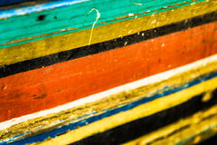 Colorful wood. Detail of an old retro bench. The tree is painted with paint stock photography