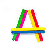 Colorful wood ice-cream stick to create A  on white background. Stock Photos