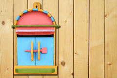 Colorful wood mailboxes on wood wall Royalty Free Stock Images