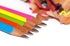 Colorful wood pencils and shavings on white Royalty Free Stock Photography