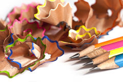 Colorful wood pencils shavings on white Stock Image