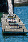 Colorful Wood Picnic Tables on a Floating Pier Stock Photography