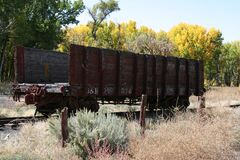 Old wooden rail car sits abandoned in Rocky Mountains Royalty Free Stock Photography