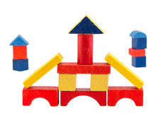 Colorful wood toy brick construction on white Royalty Free Stock Photography