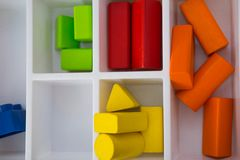 Colorful wood toy building blocks. In white tray, play and learn concept stock images