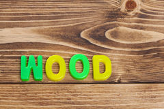 Colorful Wood word on wooden background Stock Photography