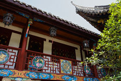 Colorful woodcarvings of aged building Stock Images