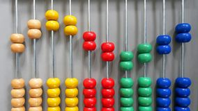 Colorful Wooden Abacus Beads in Sine Wave Pattern. On Gray Background Stock Photos