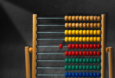 Colorful Wooden Abacus on a Blackboard Royalty Free Stock Photography