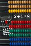 Colorful Wooden Abacus and Calculator Stock Photos