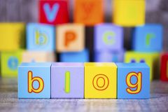 Colorful wooden alphabet, blog write. Education concept photo.  stock image