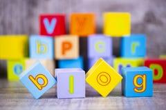 Colorful wooden alphabet, blog write. Education concept photo.  stock images
