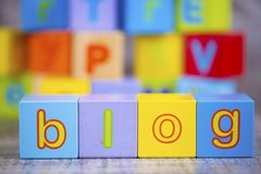 Colorful wooden alphabet, blog write. Education concept photo.  royalty free stock image