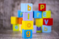 Colorful wooden alphabet, blog write. Education concept photo.  royalty free stock photography