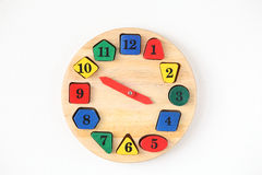 Colorful wooden and any shape clock isolated on a white backgrou Royalty Free Stock Images