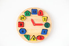 Colorful wooden and any shape clock isolated on a white backgrou Stock Photos