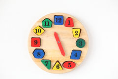 Colorful wooden and any shape clock isolated on a white backgrou Stock Photo