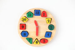 Colorful wooden and any shape clock isolated on a white backgrou Royalty Free Stock Photo