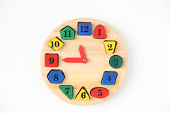 Colorful wooden and any shape clock isolated on a white backgrou Royalty Free Stock Photography