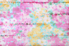 Colorful wooden background with floral pattern Stock Photo