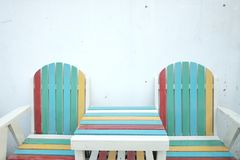 Colorful wooden beach bench with table on the ground floor stock photos