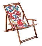Colorful wooden beach chair isolated on white. Colorful folding wooden beach with a bold patterned canvas seat chair isolated on white Royalty Free Stock Photos