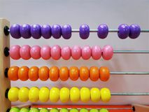 Colorful Wooden Beads of Abacus for Kids to Learn Basic Math. Close-up Colorful Wooden Beads of Abacus for Kids to Learn Basic Math royalty free stock images