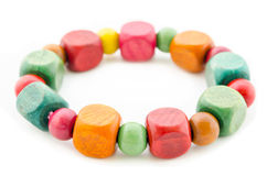 Colorful wooden beads bracelet. Stock Photo