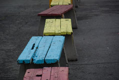 Colorful wooden benches outdoors Royalty Free Stock Images