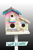 Colorful wooden bird house with hole on white background Stock Photos