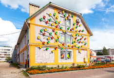 Colorful wooden birdhouses mounted on the facade of the building. BOROVICHI, RUSSIA - AUGUST 3, 2016: Colorful wooden birdhouses mounted on the facade of the stock image