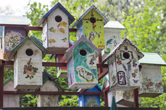 Colorful wooden birdhouses in the Park. Birdhouses in Sokolniki Park, Moscow stock images