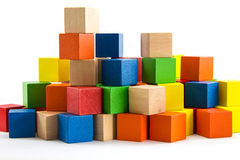 Colorful wooden blocks Arranged by the imagination. Stock Photos