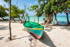 Colorful wooden boat on the coast of the island, Maldives Royalty Free Stock Image