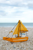 Colorful wooden boat figure on the beach in the evening Royalty Free Stock Photos
