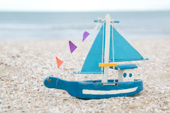 Colorful wooden boat figure on the beach in the evening Stock Photo