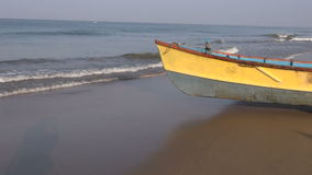 Colorful wooden boat on Kerala beach, India stock video footage