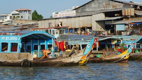 Colorful Wooden Boat on the Mekong River stock photo