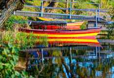 Colorful wooden boat at the riverbank Royalty Free Stock Photo