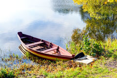 Colorful wooden boat at the riverbank Royalty Free Stock Photos