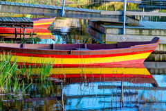 Colorful wooden boat at the riverbank Stock Photography