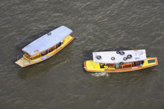 Colorful wooden boats. Aerial view of colorful wooden boats on a river in Bangkok Stock Photo