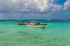 Colorful wooden boats on azur beautiful Caribbean, Dominican Republic stock images