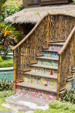 Colorful wooden bridge in a tropical garden next to the swimming pool . Bali, Indonesia Royalty Free Stock Photography